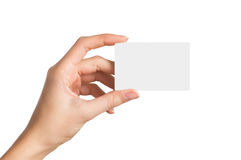 Hand holding blank business card. Closeup shot of a woman hand holding blank business card isolated on white background. Close up hand showing visit card Royalty Free Stock Photos