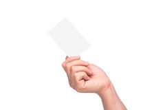 Hand holding blank business card isolated Royalty Free Stock Images