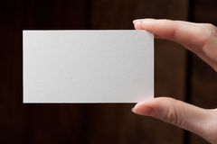 Hand holding a blank business card Royalty Free Stock Images
