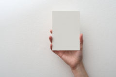 Hand holding blank card Stock Images