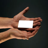 Hand holding a blank credit card Royalty Free Stock Photo