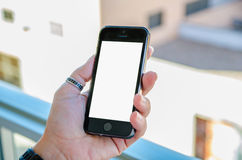 Hand holding blank mobile phone Royalty Free Stock Photos