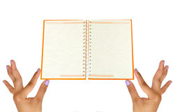 Hand holding blank notebook Stock Photography