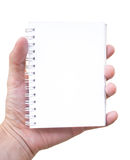 Hand holding blank notepad. Hand holding blank palm-sized notepad isolated on white Royalty Free Stock Photos