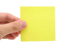 Hand holding blank notepaper. With white background Royalty Free Stock Image