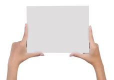 Hand holding blank paper 4. Close up of hands holding blank paper isolated on white background Royalty Free Stock Photo