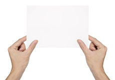 Hand holding blank paper  isolated Royalty Free Stock Photography