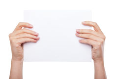 Hand holding blank paper isolated Royalty Free Stock Image