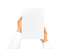 Hand holding blank paper sheet. Corporate letterhead Stock Image