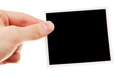 Hand holding blank photo Royalty Free Stock Photo