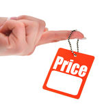 Hand holding blank price tag Royalty Free Stock Photos