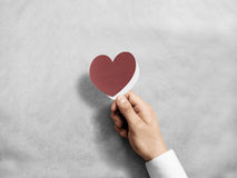 Hand holding blank red valentine`s card mockup. Royalty Free Stock Photography
