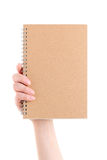 Hand holding blank spiral notebook Stock Image