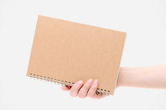 Hand holding blank spiral notebook Royalty Free Stock Image