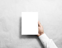 Hand holding blank white brochure booklet. In the hand. Leaflet presentation. Pamphlet hold hand. Man show book offset paper. Sheet template. Booklet design stock photo
