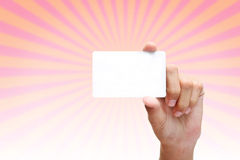 Hand holding blank white business card stock image