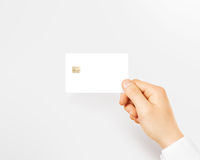 Hand holding blank white credit card mockup isolated. Stock Image