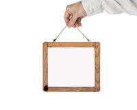 Hand holding blank white message board isolated on white Stock Photography