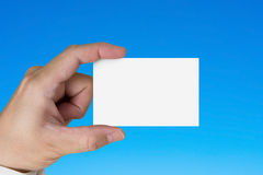 Hand holding blank white name card Stock Photo