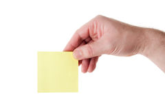 Hand Holding a Blank Yellow Paper Stock Image