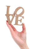 Hand holding block wooden letters, word love Stock Photos