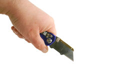 Hand holding Blue anodized contractors razor knife Stock Images