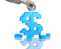 Hand holding blue block complete dollar sign shape Stock Photography