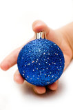 Hand holding a blue christmas ball Stock Photos