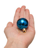 Hand holding a blue Christmas toy. Hand holding a blue Christmas ornament on a white background Stock Photo