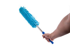 Hand holding blue dust brush with plastic and aluminum handle on Stock Photography