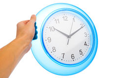 Hand holding blue office clock Stock Photo