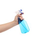 Hand holding blue plastic spray bottle Stock Photo