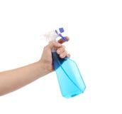 Hand holding blue plastic spray bottle Stock Photo