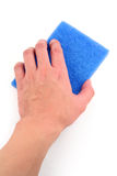 Hand holding blue scrubber Royalty Free Stock Images