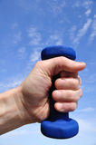 Hand Holding Blue Weight Royalty Free Stock Image