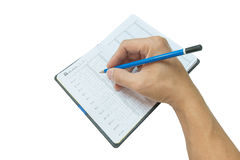 Hand holding the blue wood pencil on  blank page Stock Image