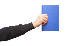 Hand holding a book Stock Image