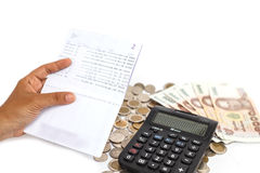 Hand holding book bank and stack of money in consept checking mo Royalty Free Stock Photos