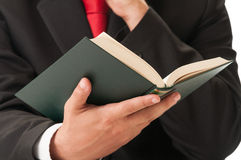 Hand holding a book. Business man or lawyer hand holding a book Stock Photos