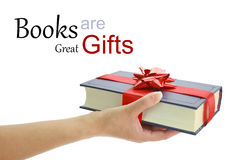 Hand holding a book for gift Stock Photos