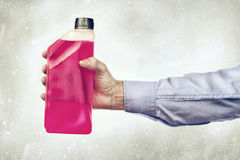 Hand Holding a Bottle of Antifreeze Stock Photography