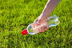 Hand holding a bottle of pure water stock image