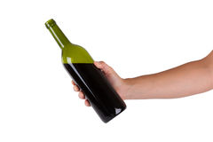 Hand holding a bottle of red wine Royalty Free Stock Photos