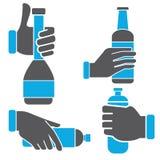 Hand holding bottle Stock Images