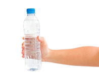 Hand holding a bottle of water Royalty Free Stock Images
