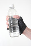Hand holding a bottle of water Royalty Free Stock Photo