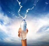 Hand holding a bottle of water stock images