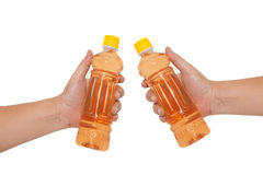 Hand holding a bottle Stock Photo
