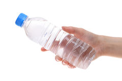 Hand holding bottle of water Stock Photos