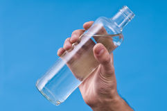 Hand holding bottle of watter. Royalty Free Stock Photography